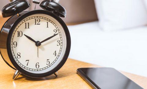 Clock next to a smartphone